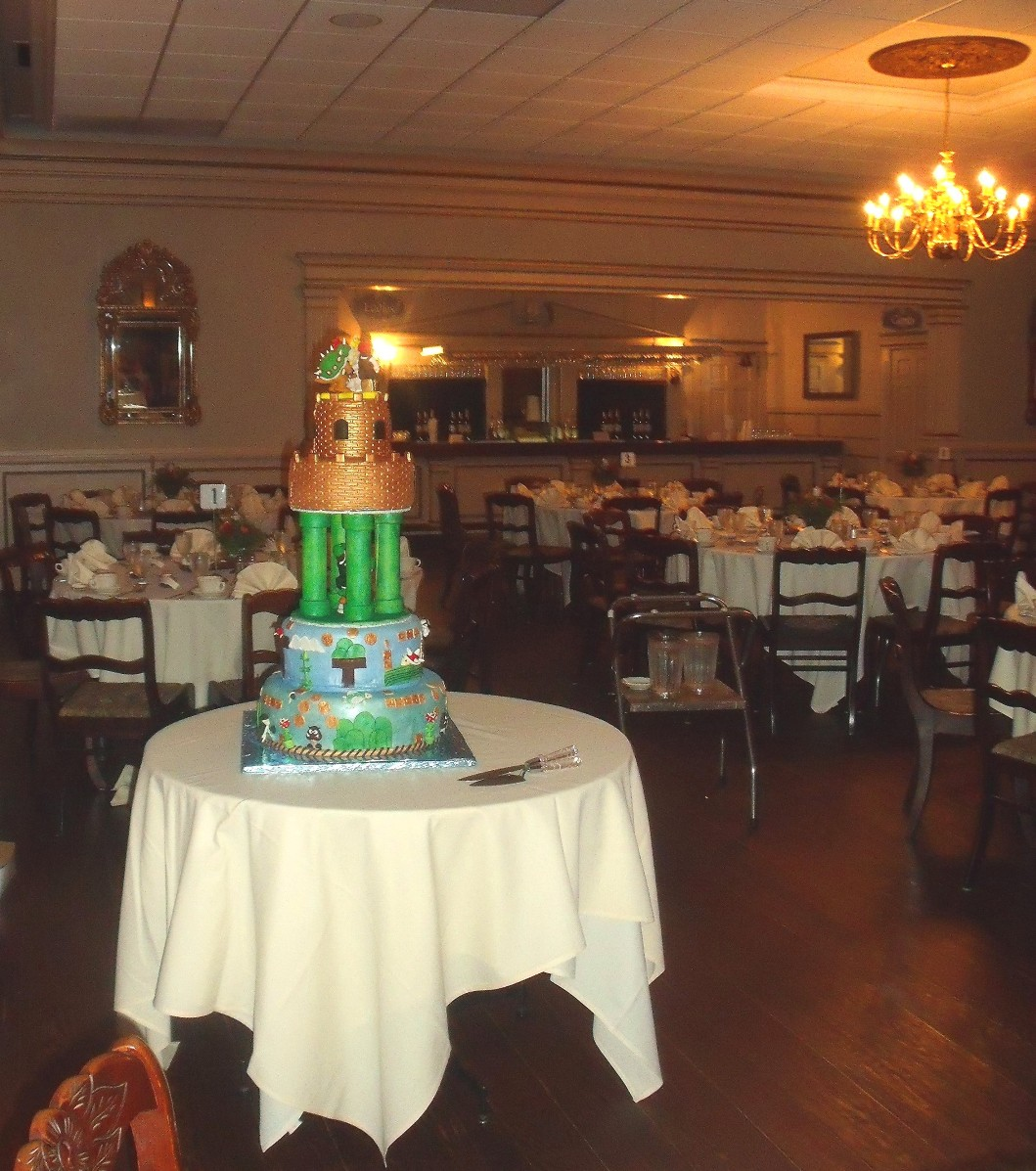 Mario video game theme wedding cake in reception room for Video for weddings