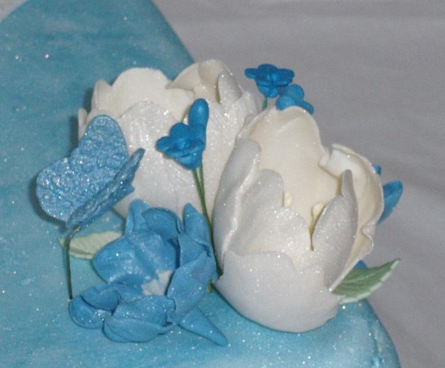 Pregnant Baby Shower close up of floral arrangment - tulips, butterfly, blue flowers