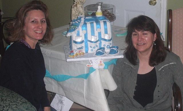 Debbie Moran and Tanya Foster with cake