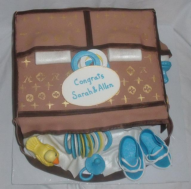 Louis Vuitton Baby Bag Cake with Gumpaste Duck, Baby Rings, Shoes, and Rings top view
