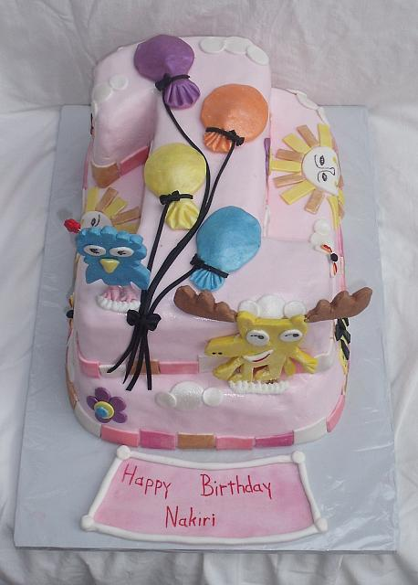 Moose And Zee Carved Number 1 First Birthday Cake with Whimsical Decorations main view