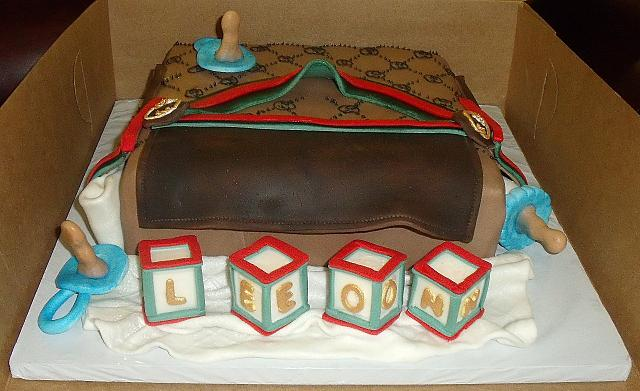 Gucci Baby Diaper Bag Cake With Edible Baby Blocks, Pacifiers, Baby Bottle front view