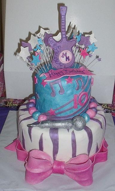 Hannah Montana Cake with Microphone, Exploding Stars, Zebra Stripes, and Large Bow front view