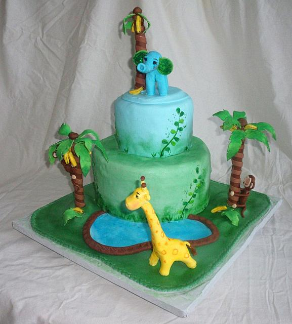 Jungle or Safari Baby Shower Cake with Edible Monkey in Banana Trees, Elephant, Giraffe, and Pond view 1