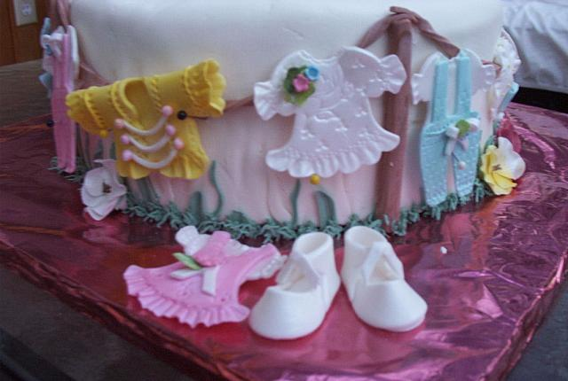 Closeup of edible gumpaste baby clothes(not the clearest pictures!  sorry)