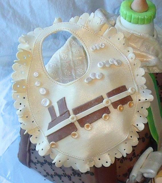 Close up of Edible Gumpaste Baby Bib for Boy Decoration