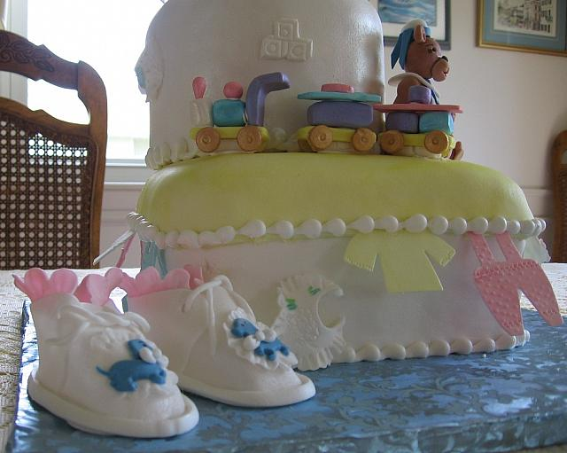 Another close up of the baby shower cake with baby shoes