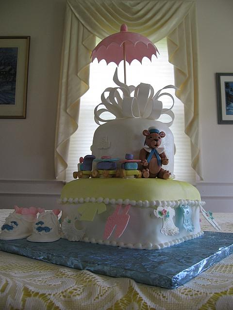 Another view of the baby shower cake with baby shoes