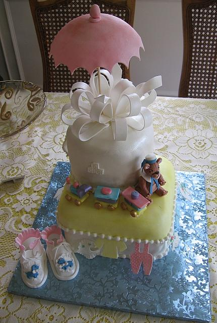 Top view of the baby shower cake with baby shoes