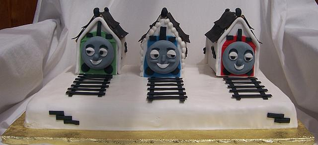 Front view of Thomas the Train cake.  Tracks are made out of edible gumpaste.