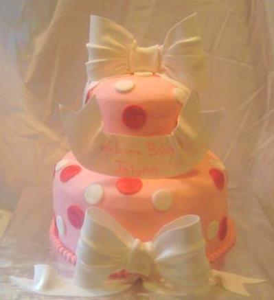 Pink Cake With Polka Dots and edible gumpaste White Bows and banner - Front view