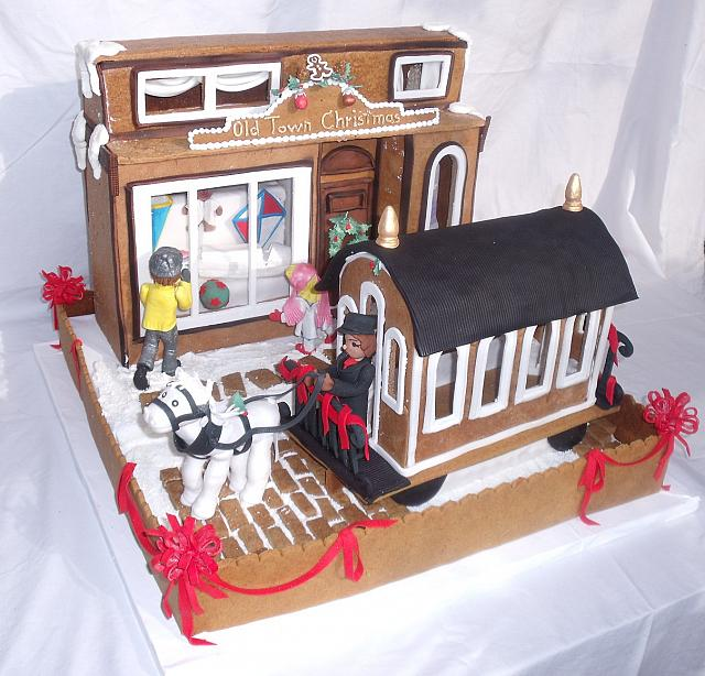 main view of gingerbread creation with all edible gumpaste, fondant, gingerbread, royal icing decorations