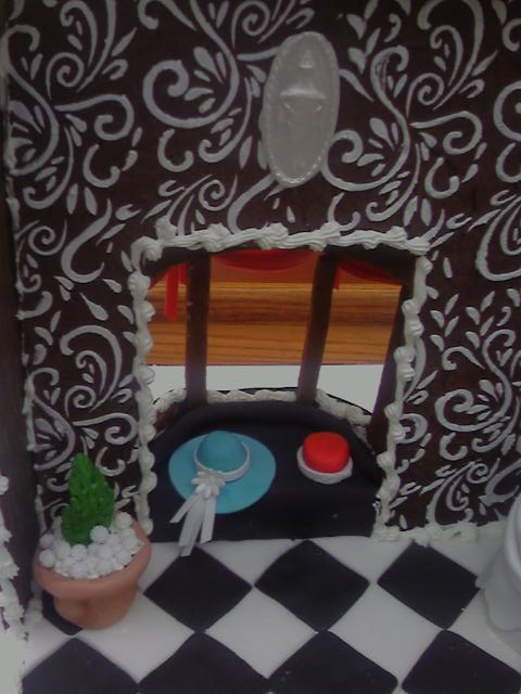 2008 Gingerbread Ladies Dress Shop - close up of inside window with two hats