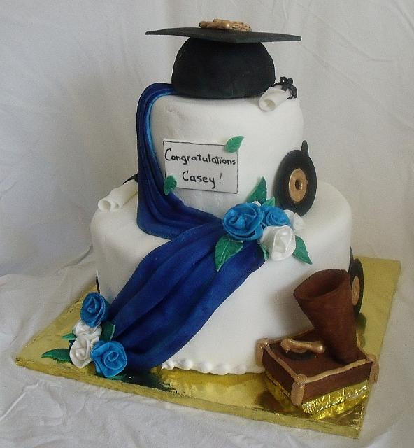Blue and White Graduation Cake With Music Theme - notice vinyl record on cake side