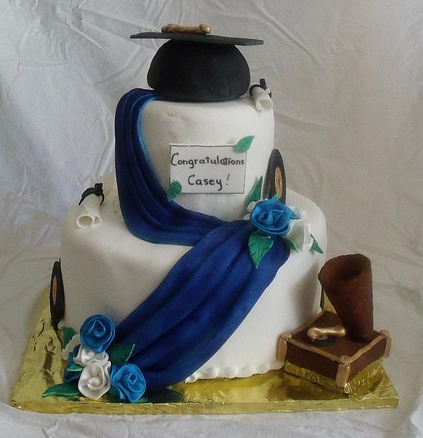 Blue and White Graduation Cake With Music Theme main view