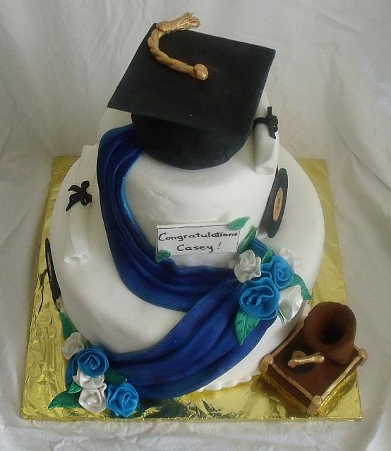 Blue and White Graduation Cake With Music Theme top view