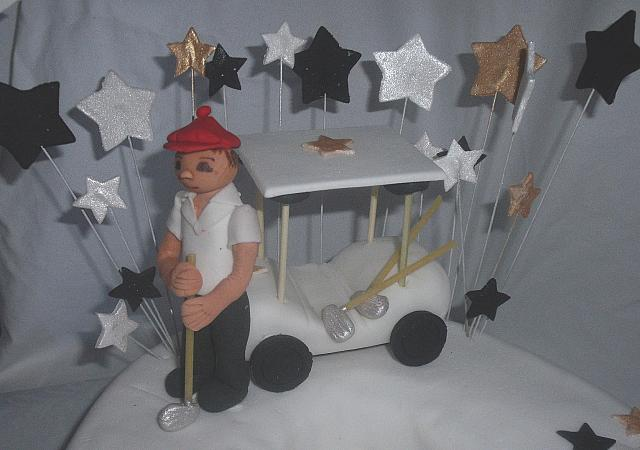 Close up of edible gumpaste golfer, golf cart, and golf clubs