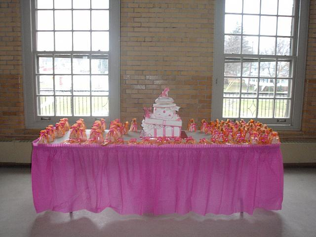Quinceanera Cake in Pink and White with Stacked Presents, Edible Fashion Shoe, Pillow, and Princess Crown on table