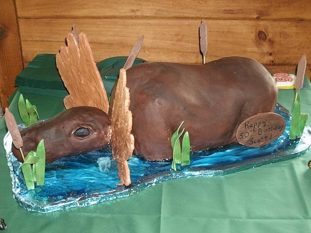 Carved Moose Cake Sitting In Pond main view