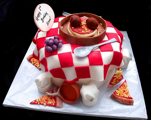 Pizza and Italian Food Themed Fondant Cake with Edible Chef Hats, Copper Pots, Grapes, Spagetti side view
