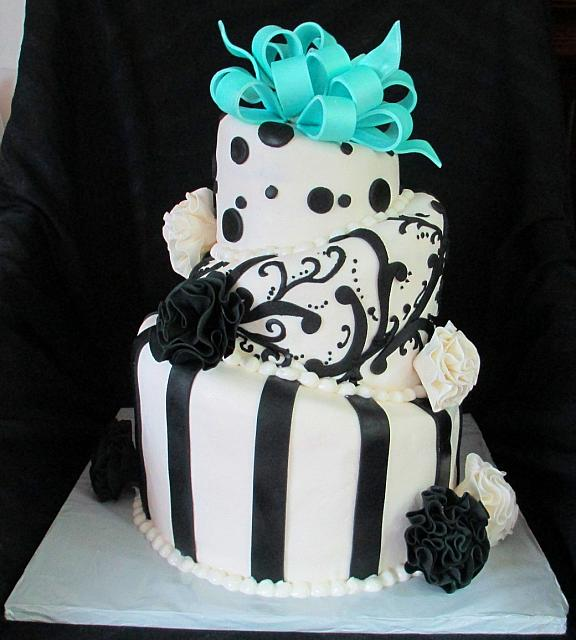 Whimsical Topsy Turvy Black and White Fondant Cake with Teal Bow and Fantasy Flowers main view