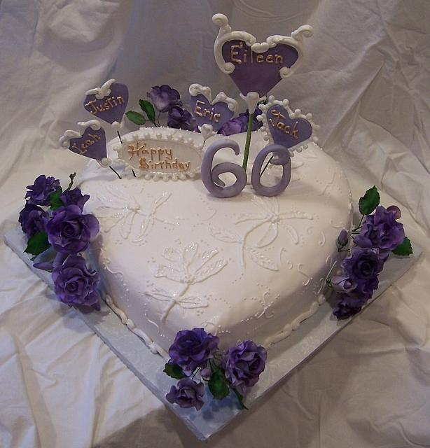 Heart shaped cake With Purple Roses and Victorian style purple sugarpaste hearts