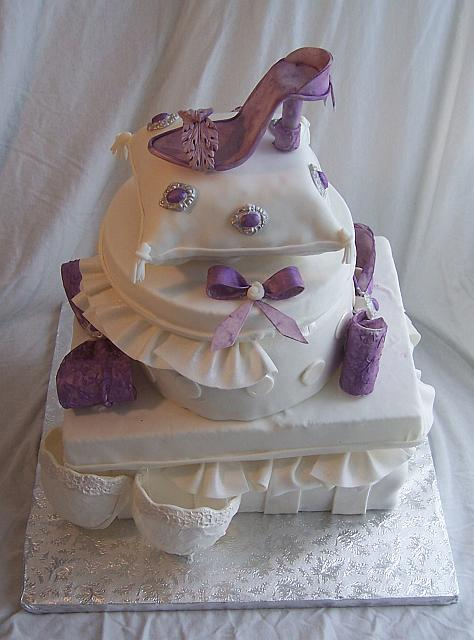 Top view of Metta's Bridal Shower cake of Stacked presents - notice the jewels on the pillow and the shoe detail