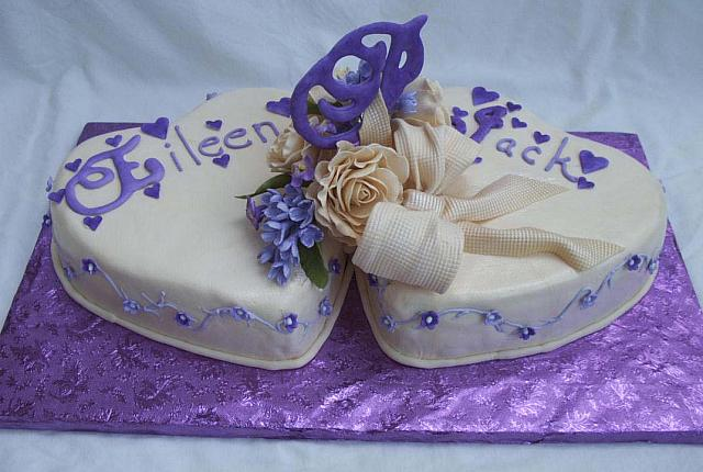 Purple heart wedding cake with gumpaste flowers and decorations