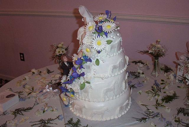 another view of wedding cake with lots of edible gumpaste flowers