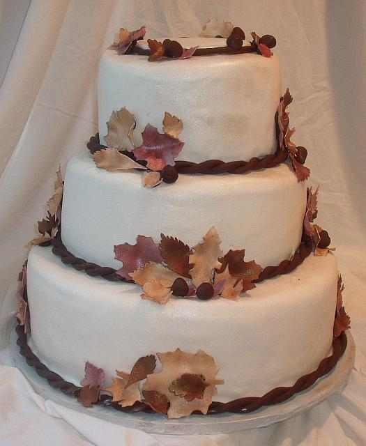 Fall Leaves Wedding Cake with Burgundy, Brown, and Beige Edible Gumpaste Leaves and Dark Chocolate Acorns main view
