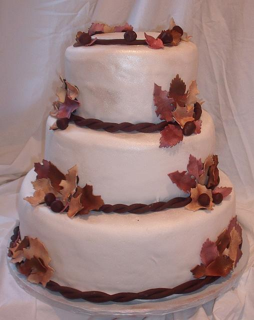 Fall Leaves Wedding Cake with Burgundy, Brown, and Beige Edible Gumpaste Leaves and Dark Chocolate Acorns view 2
