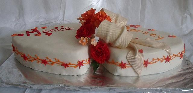 Wedding Cake of Two Hearts,  Red Gumpaste Roses,  Orange Hydrangea Gumpaste Flowers, side view