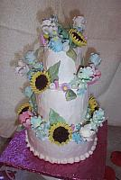 Gumpaste sunflowers, irises, and tulips.  All decorations are edible.