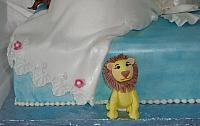 Pregnant Baby Shower Cake close up of edible, handmade Lion