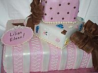 Baby Shower Tiered cake close up of colorful middle present with edible baby decorations
