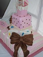 Baby Shower Tiered cake close up of brown textured edible bow