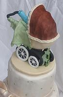 Old fashioned or old time baby carriage with blue gumpaste baby elephant back view