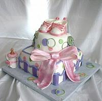 Whimsical Baby Shower Cake in Pink, Green, and Purple with Edible Gumpaste baby Shoes, Baby Bottle, and Safety Pins view 1