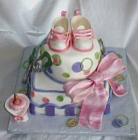 Whimsical Baby Shower Cake in Pink, Green, and Purple with Edible Gumpaste baby Shoes, Baby Bottle, and Safety Pins main view