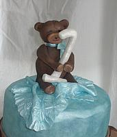 Close up of edible gumpaste teddy bear decoration for baby shower cake