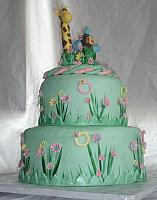 Safari or Zoo Themed Green, Pink, and Yellow Baby Shower Cake with edible Giraffe, Monkey, and Circus Elephant