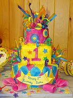 Whimsical Mardi Gras First Birthday Cake front view