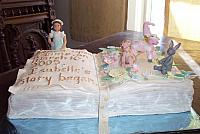 Baby book Cake or Christening Cake with gumpaste figurines and fondant