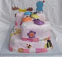 Moose And Zee Carved Number 1 First Birthday Cake with Whimsical Decorations back view