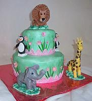 Zoo Animals Child Birthday Cake with Pink Flowers And Grass Side Design