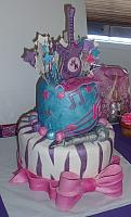 Hannah Montana Cake with Microphone, Exploding Stars, Zebra Stripes, and Large Bow side view