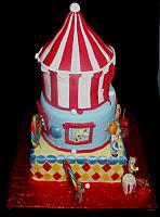 Circus or Carnival Themed Fondant Cake with Edible Clowns, Tent, Animals, and Miniature Carnival Food side view