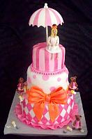 Baby Shower Fondant Cake with Mother Figurine, Umbrella, Princess Bears, Baby Bottles, Harlequin Design, Stripes, Dots, and Large Bow front view