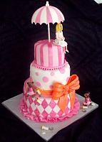 Baby Shower Fondant Cake with Mother Figurine, Umbrella, Princess Bears, Baby Bottles, Harlequin Design, Stripes, Dots, and Large Bow side view