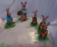 Close-close up of Mrs. Rabbit, Peter Rabbit, Flopsy, Mopsy, and Cottontail  gumpaste decorations